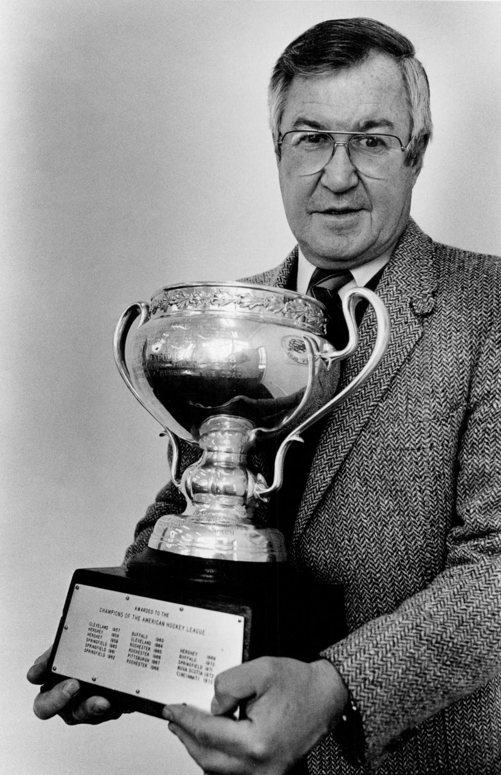 Joe Crozier holds the Calder Cup after returning to coach the Rochester Americans in October 1983. Crozier coached the Amerks to three Calder Cup titles in the 1960s.