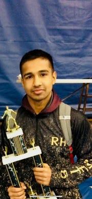 Karamvir Hothi, a 145-pounder wrestler at Rush-Henrietta