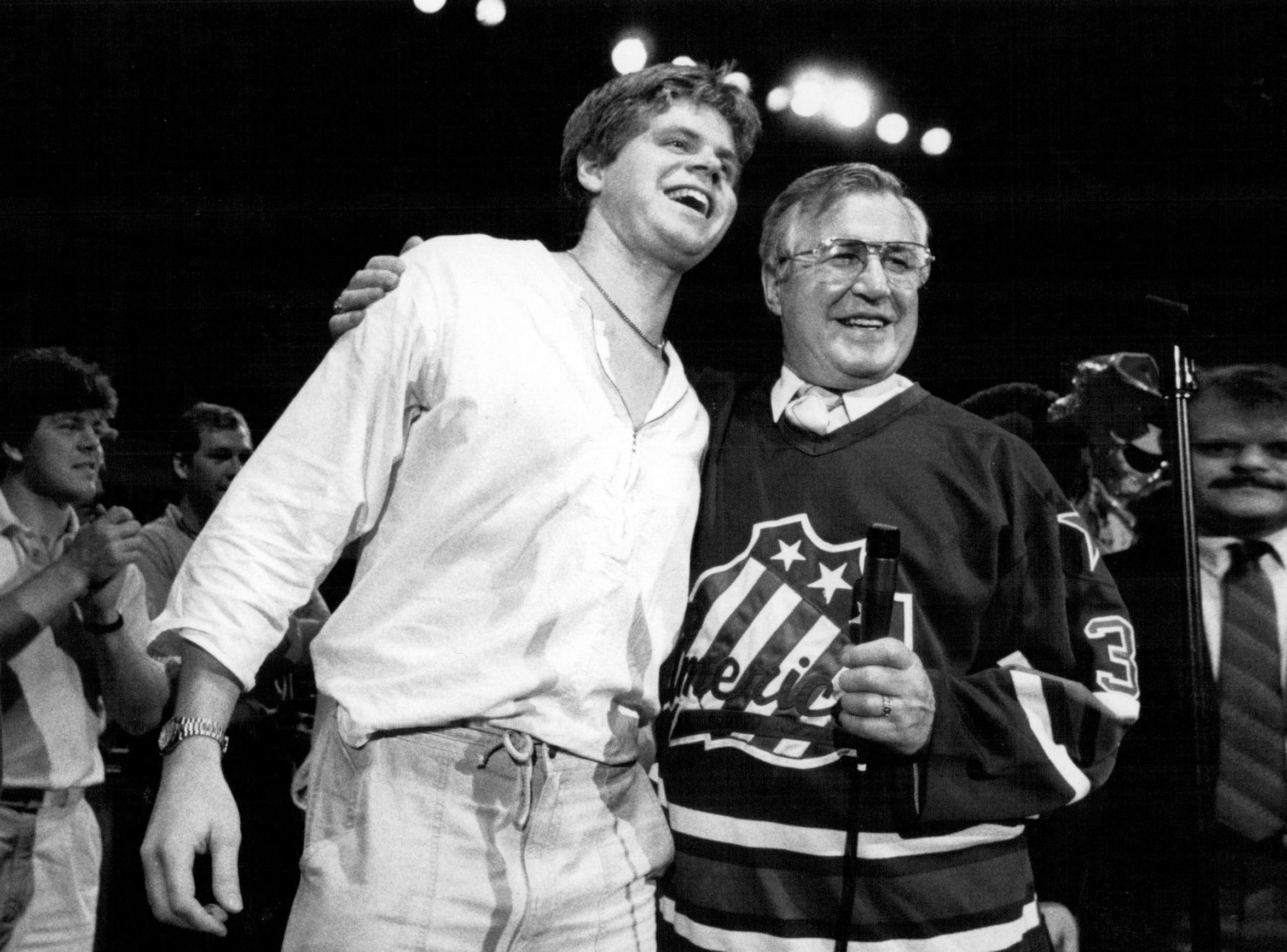 "Joe Crozier, right, a special assistant with the team, wore Daren Puppa's ""stolen"" jersey to the Rochester Americans' Calder Cup celebration in 1987."