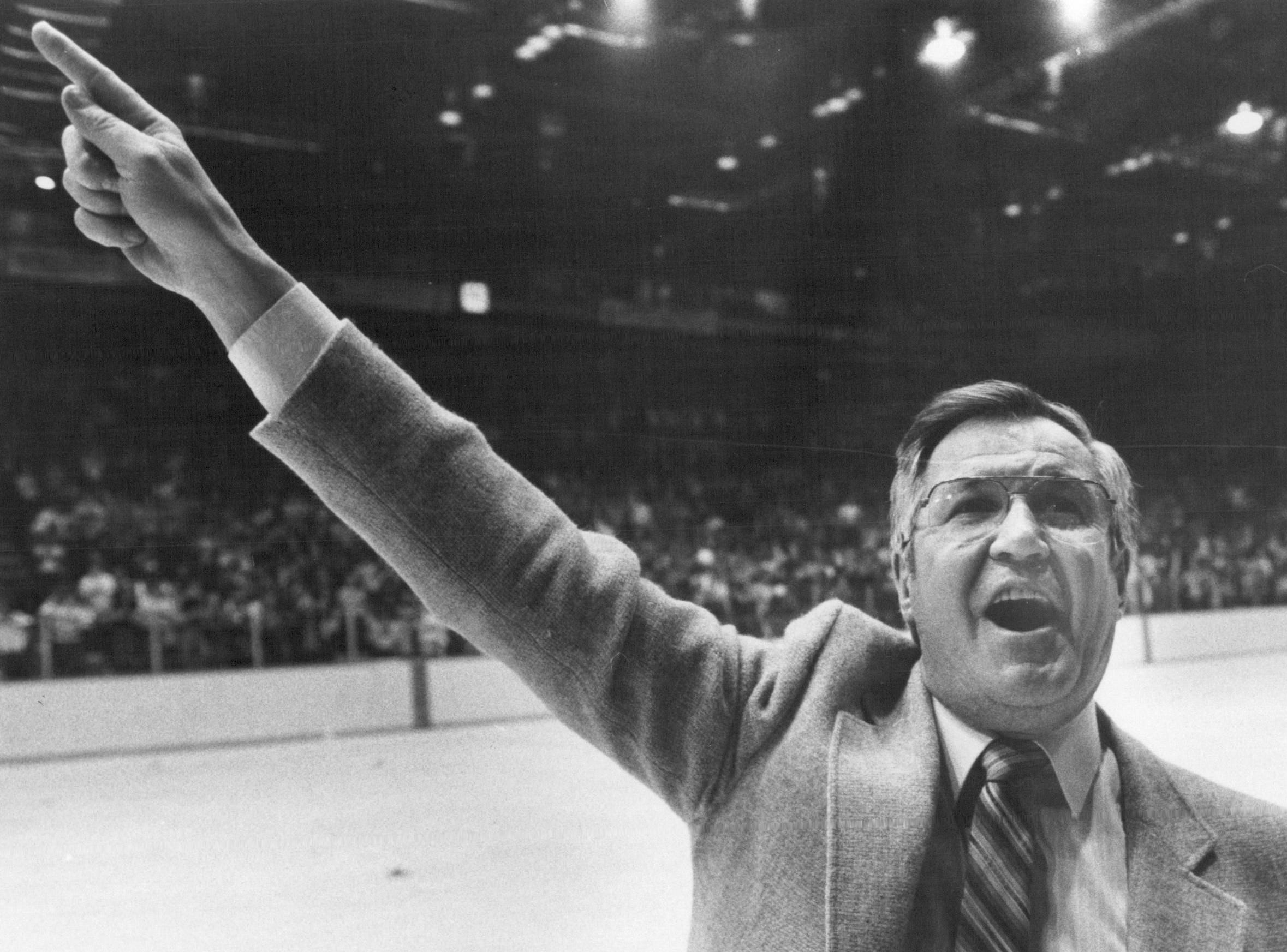 Joe Crozier points to the banners as he exits the War Memorial ice following a Calder Cup playoff game in 1984. Pointing to the banners became a ritual during the team's 1984 playoff run.