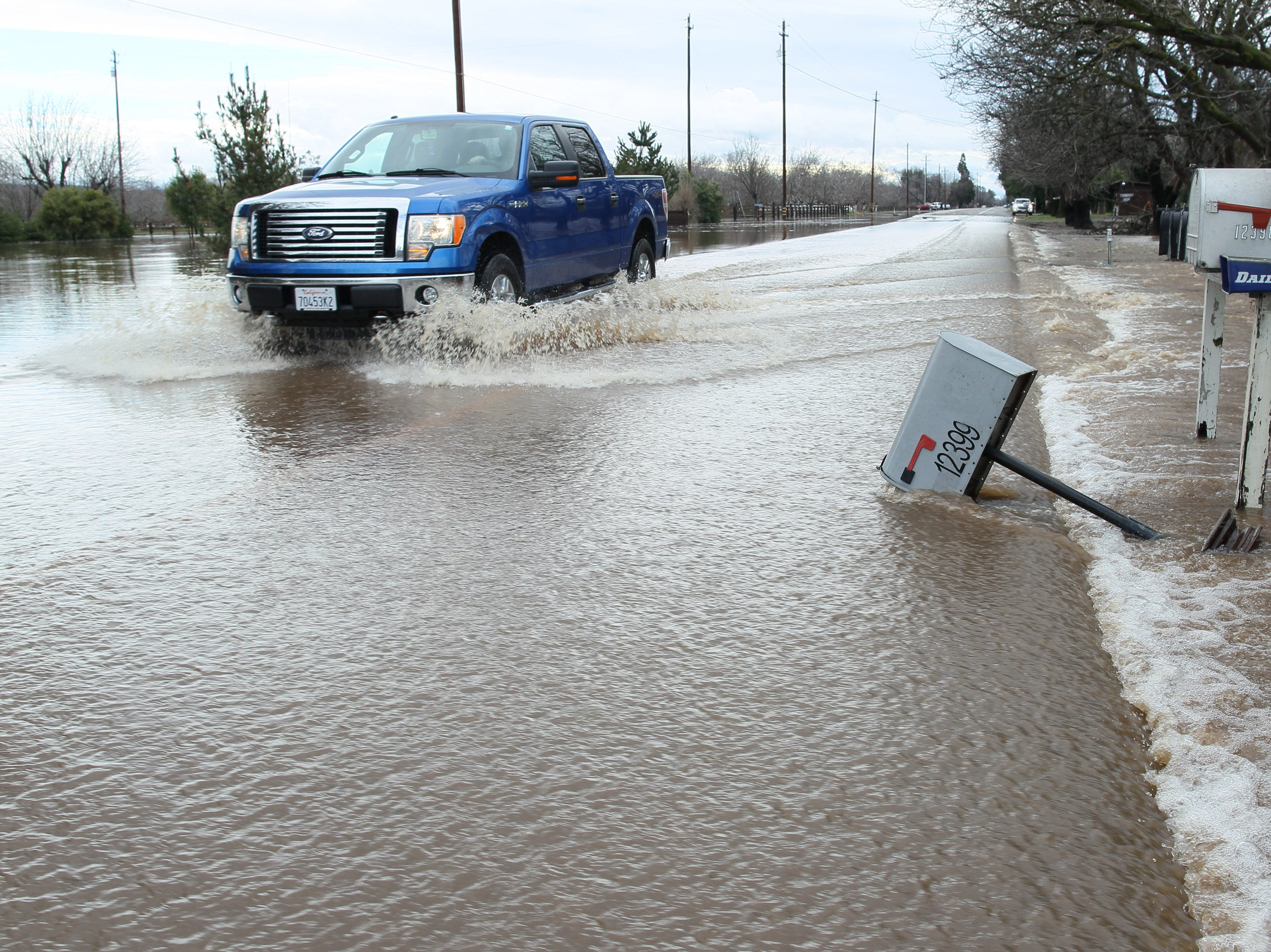 Motorist drives through the water in the flooded section on Hwy. 99 east of Red Bluff.