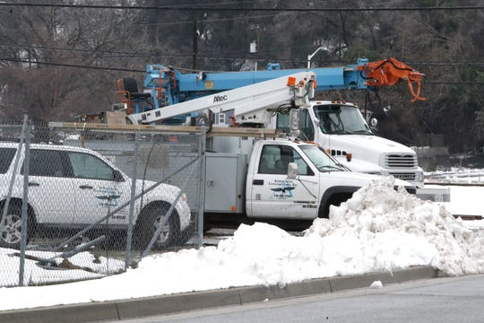 Utility crews worked to restore power in Redding on Thursday, Feb. 14, 2019.