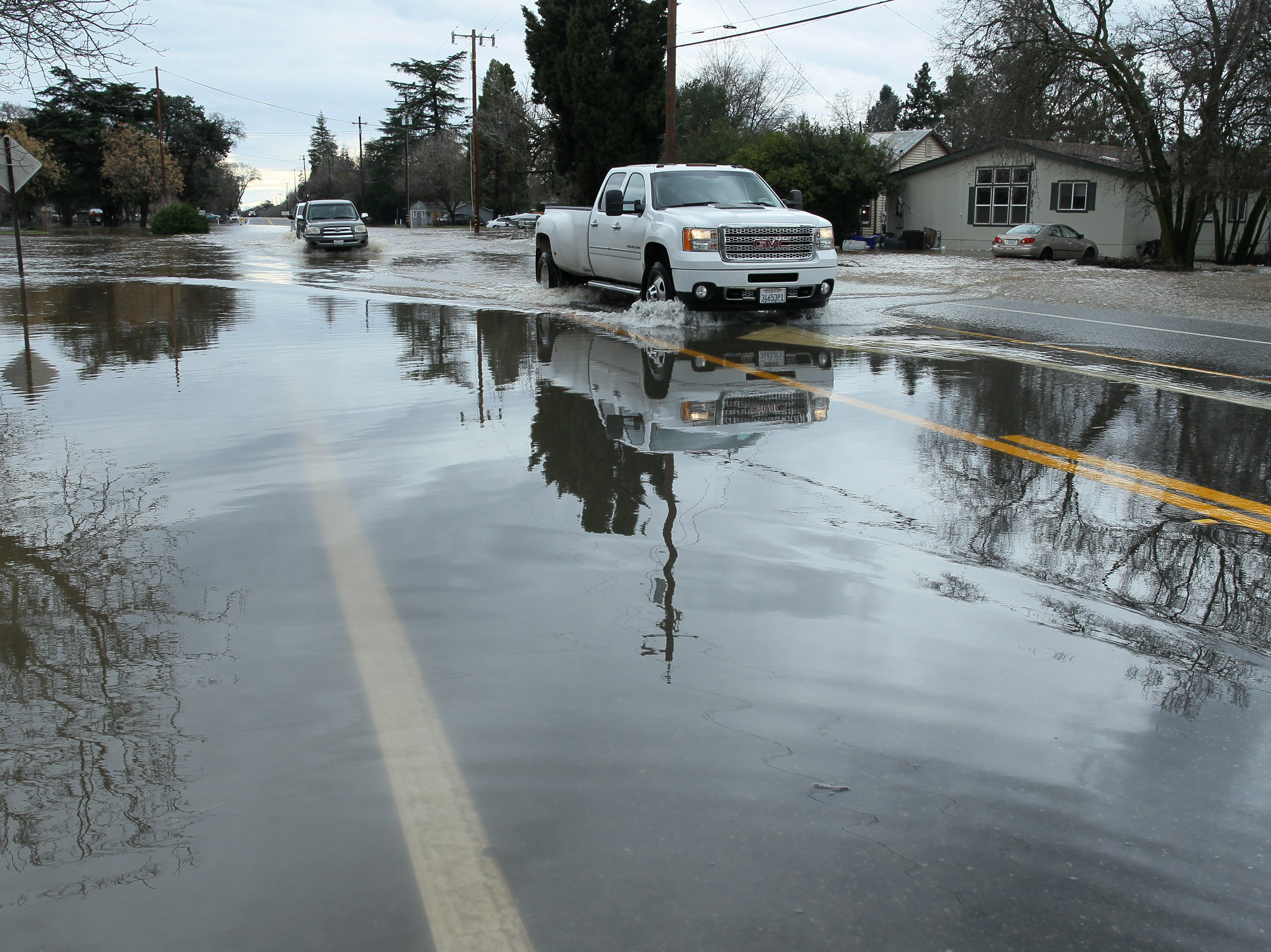 Motorists drive through the water in the flooded section on Hwy. 99 east of Red Bluff.