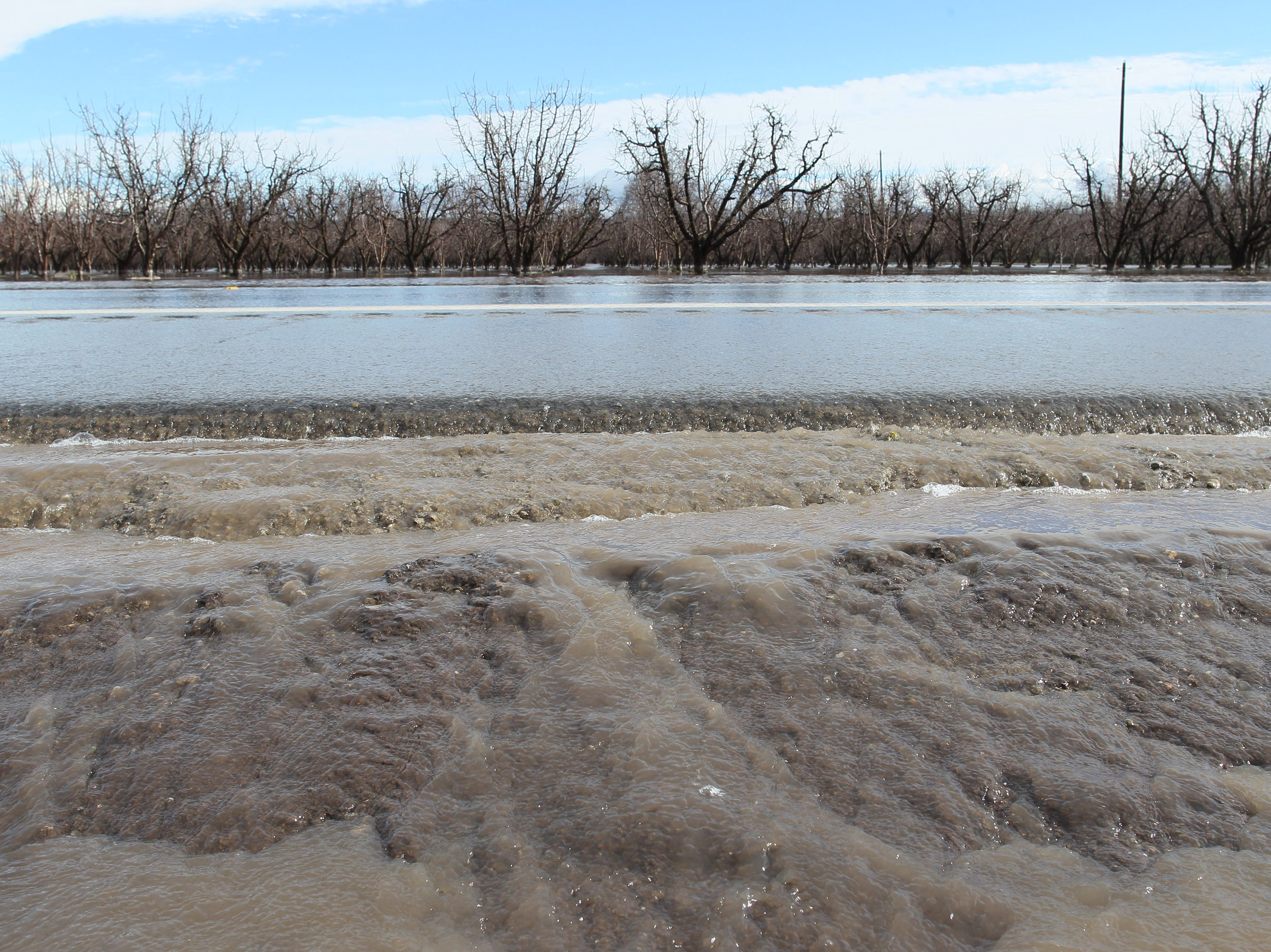 Water runs across the roadway on Hwy. 99 east of Red Bluff as seen on Thursday morning.