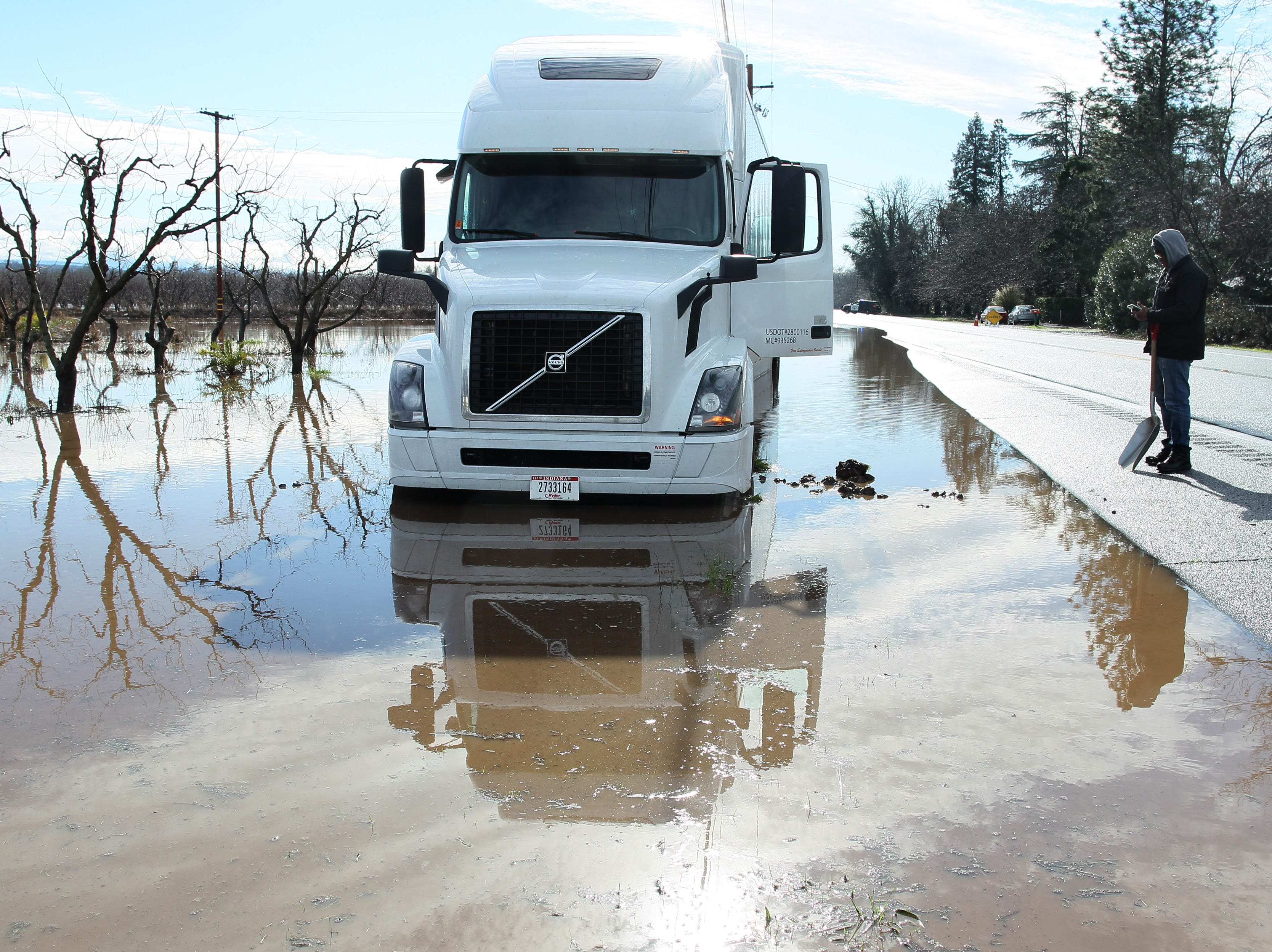 Truck driver, William Shatner,  tries to make a phone call to let his company know that his truck got stuck in the flooded area along hwy 99 east of Reb Bluff on Thursday morning.