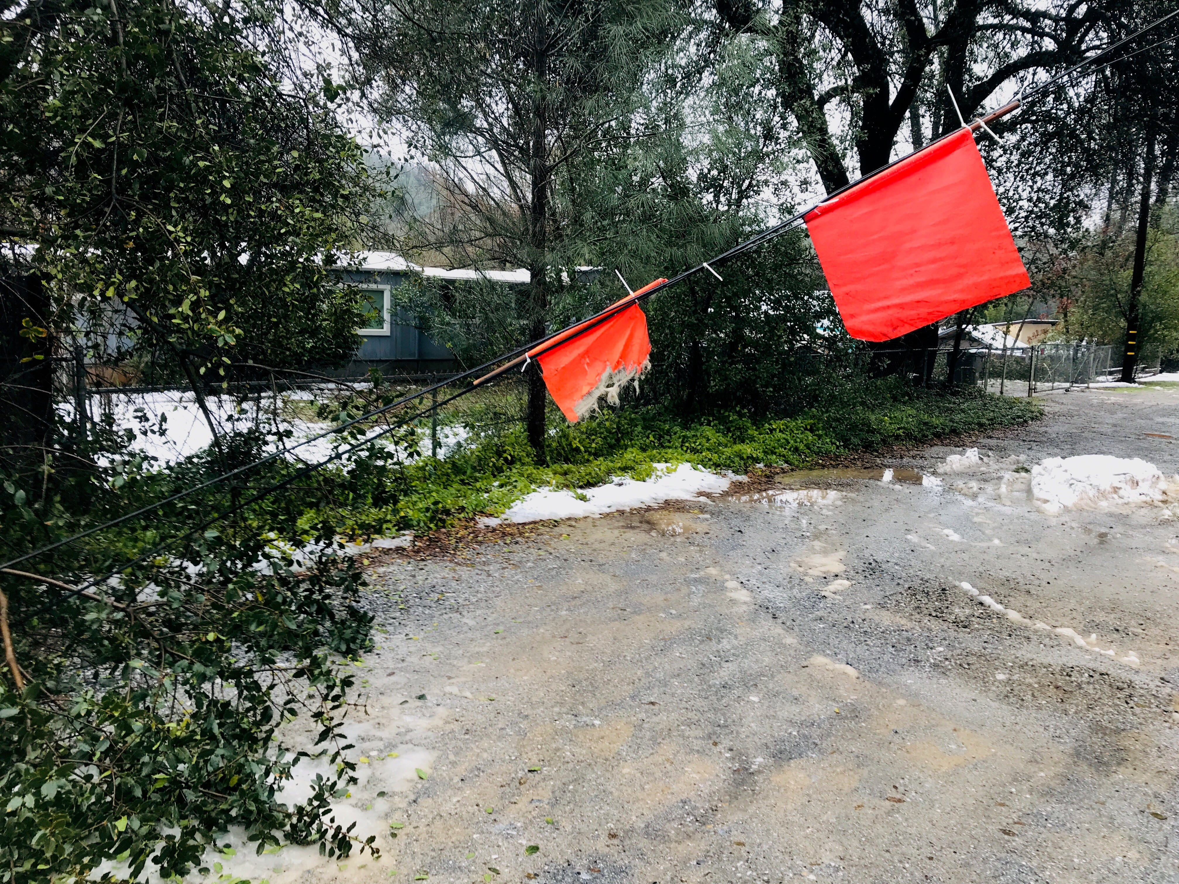 A downed power line has been flagged Thursday, Feb. 14, 2019 on Mussel Shoals Avenue in Shasta Lake, California.