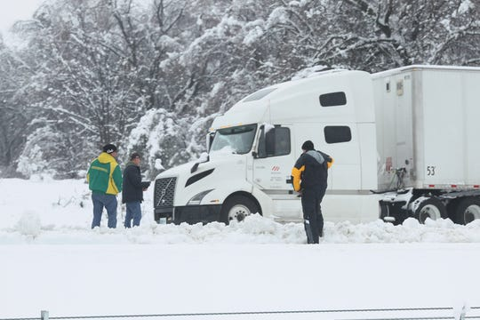 Truck drivers wait on Interstate 5 for the freeway to open northbound. I-5 was closed on Wednesday, Feb. 13, 2019 from Knighton Road in south Redding because of the snow fall. (Hung T. Vu/Special to the Record Searchlight)