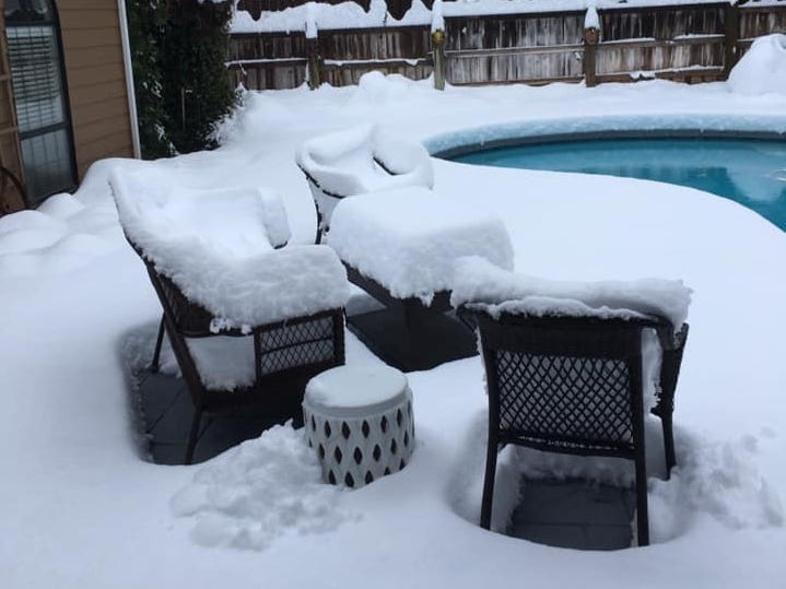 Patio furniture at the Sunset West neighborhood in Redding is covered in snow on Wednesday, Feb. 13, 2019.