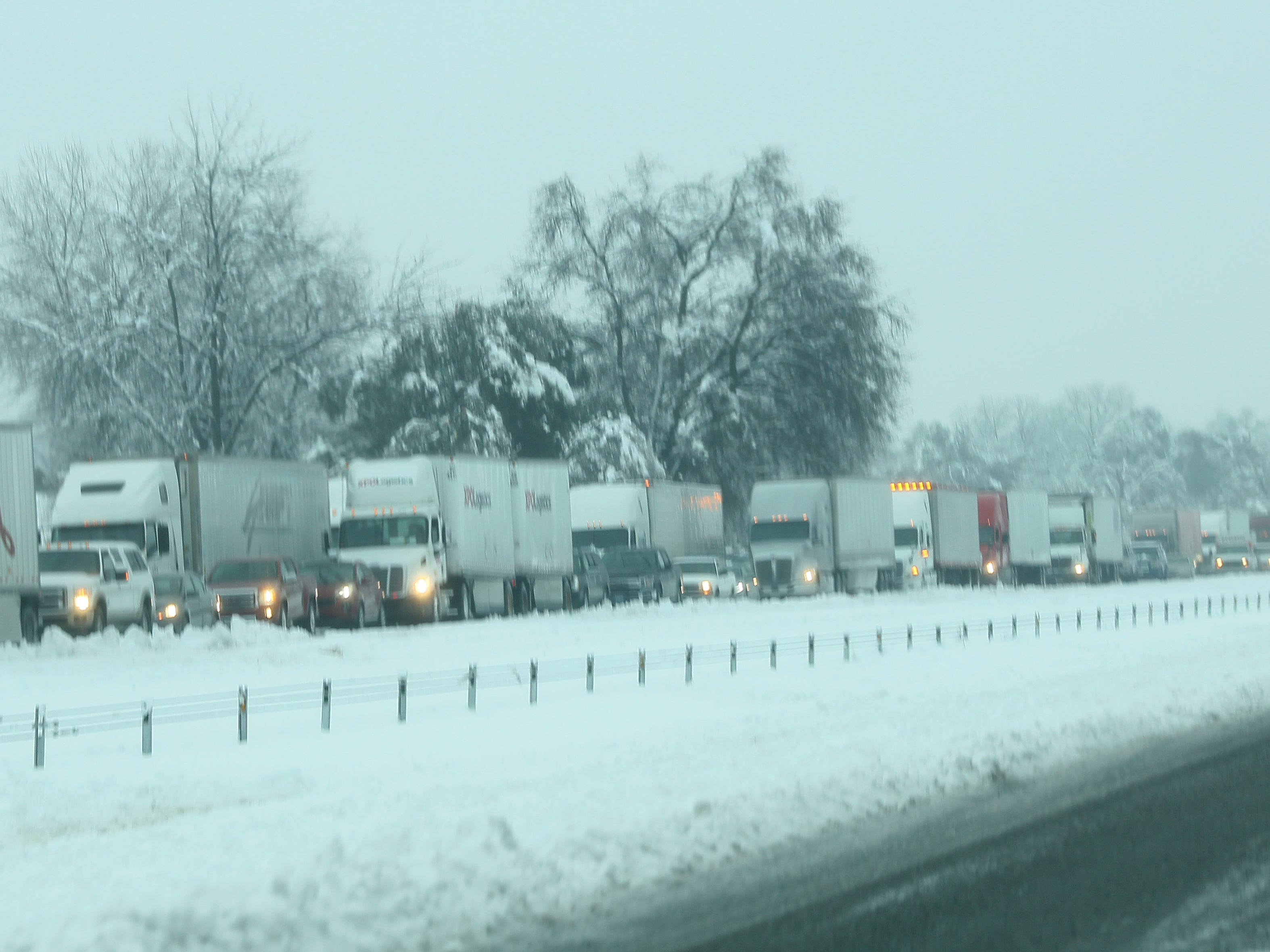 Traffic is stopped northbound Interstate 5 at Knighton Road due to snow from a winter storm Wednesday, Feb. 13, 2019 in Redding, California. (Hung T. Vu/Special to the Record Searchlight)