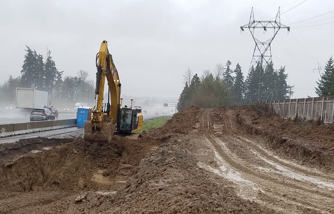 Dirt is cleared from the site of a tanker truck crash along southbound I-5 near Keizer Feb. 14, 2019.