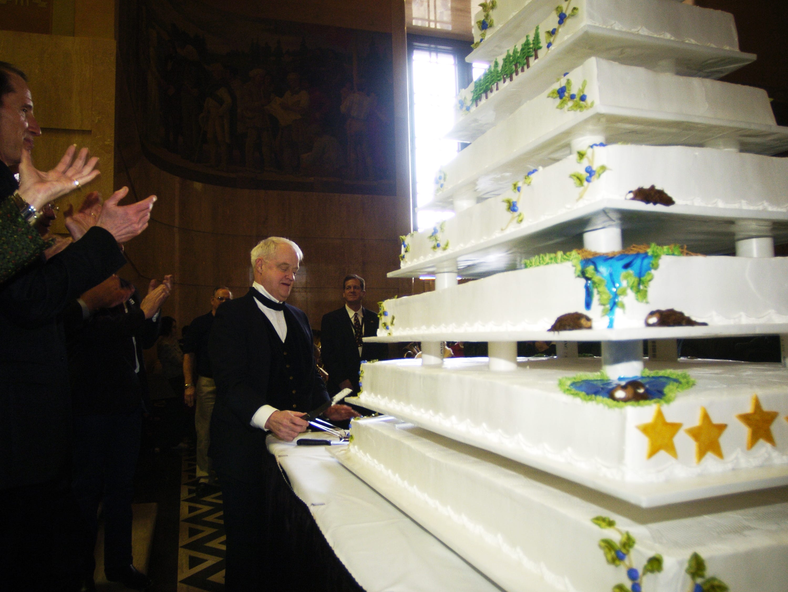 Senate president Peter Courtney cut the first slice into the birthday cake at Oregon's Sesquicentennial Birthday Celebration at the Oregon State Capitol on Feb. 14, 2009.