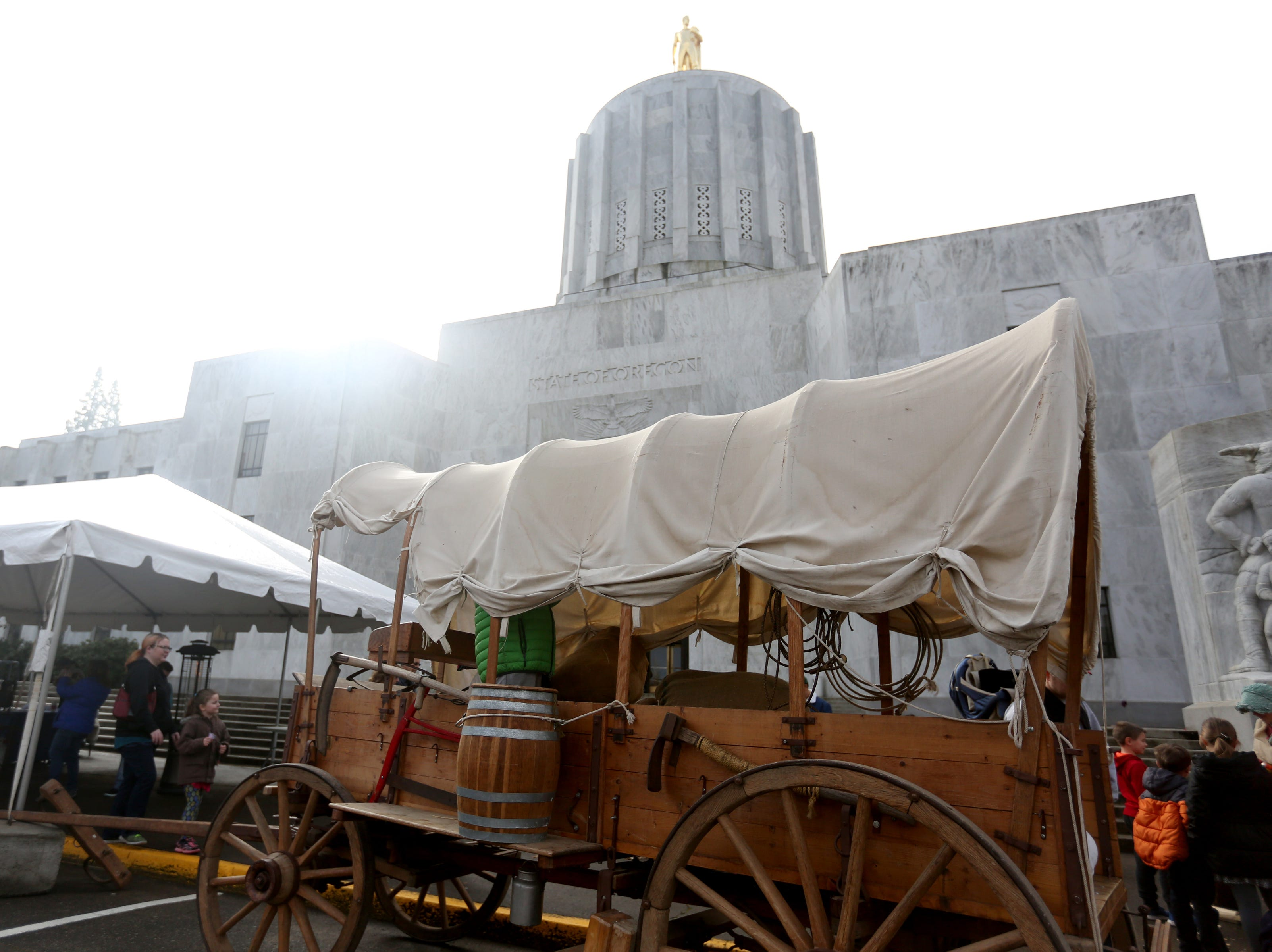 A covered wagon is parked outside during a celebration of Oregon's 158th birthday at the Oregon State Capitol in Salem on Feb. 11, 2017.