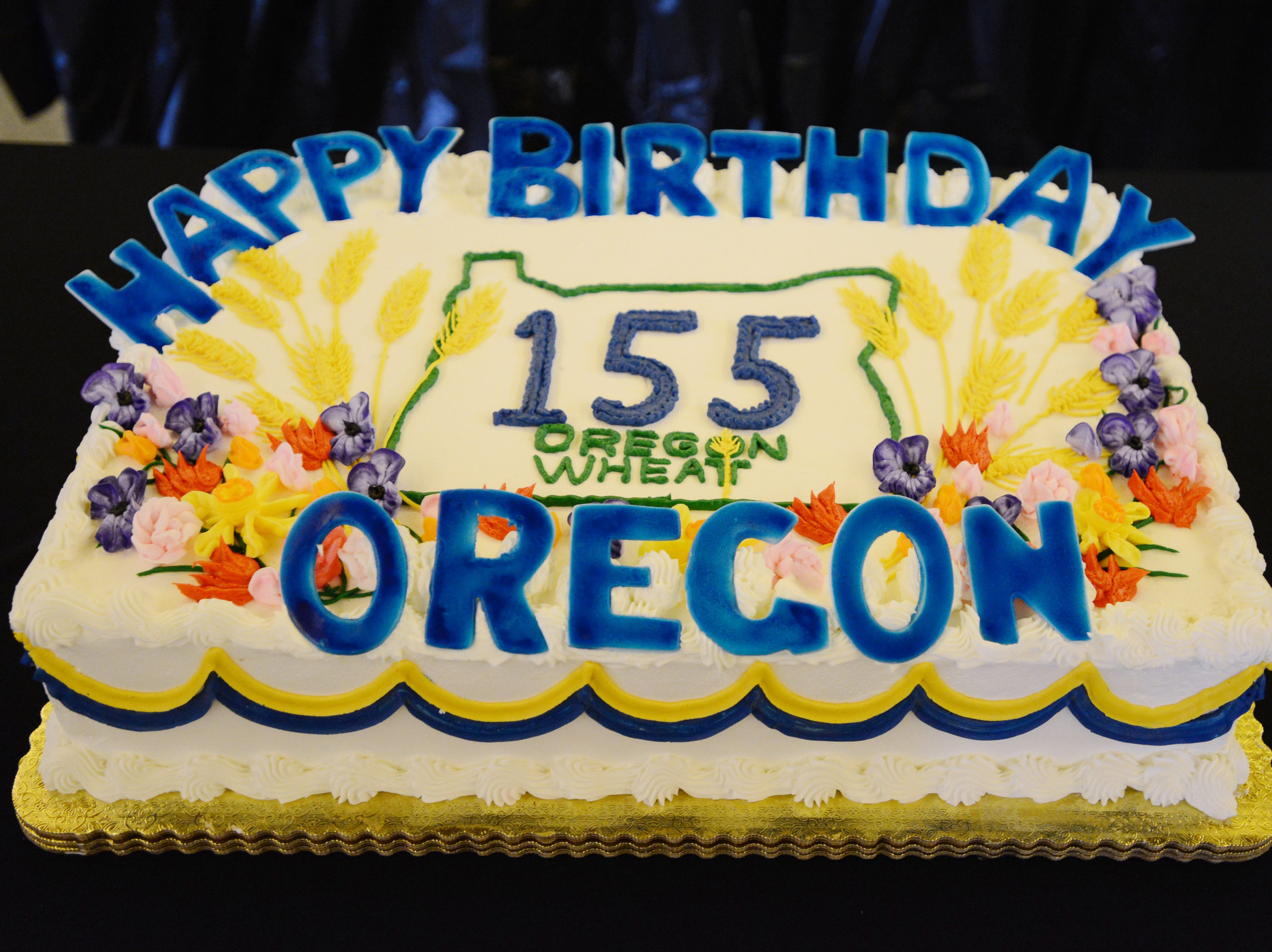 Cake is served for Oregon's 155th birthday celebration at the State Capitol on Feb. 14, 2014.