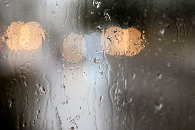 Raindrops hugs a window as cars drive by in Salem on Thursday, Feb. 14, 2019.