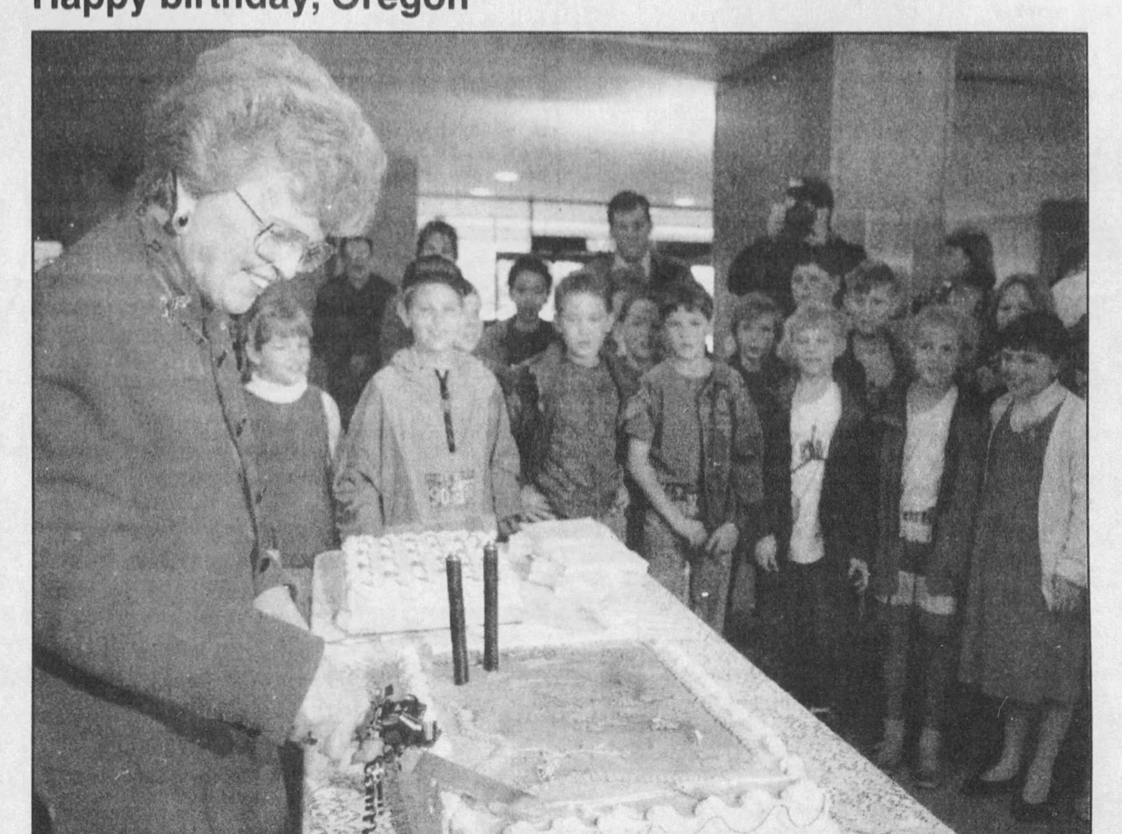 Gov. Barbara Roberts slices the cake on Oregon's 133rd birthday in 1992.