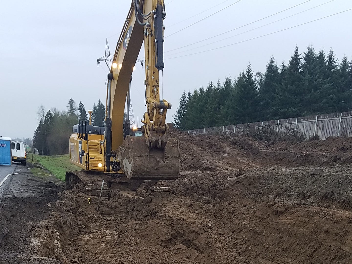 Contaminated soil is cleared from the site of a tanker truck crash along southbound I-5 near Keizer on Feb. 14, 2019.