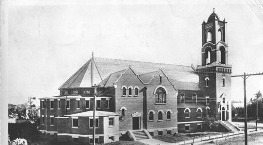 First Presbyterian Church as seen in 1910. The steeple, which loomed over the corner or Irving Street and College Avenue was dismantled years later.