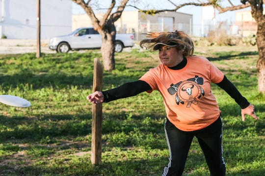 Kristi Volf tees off during a disc golf practice game Tuesday, Feb. 12, 2019, at North Concho Park.