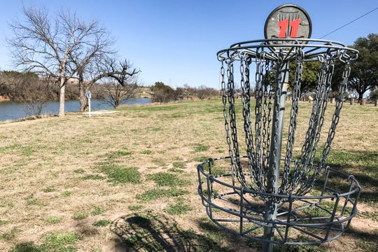 A disc golf basket at hole 11 at South Concho Park.