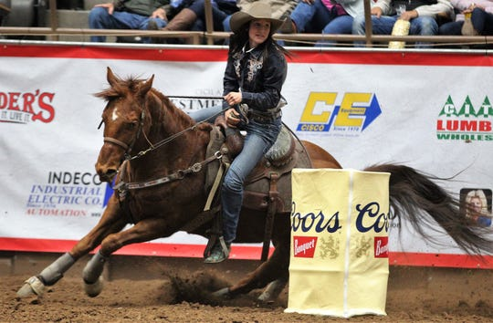 Karlee Kalberer competes in barrel racing during the 9th performance of the 87th San Angelo Stock Show & Rodeo at Foster Communications Coliseum, Wednesday, Feb. 13, 2019.
