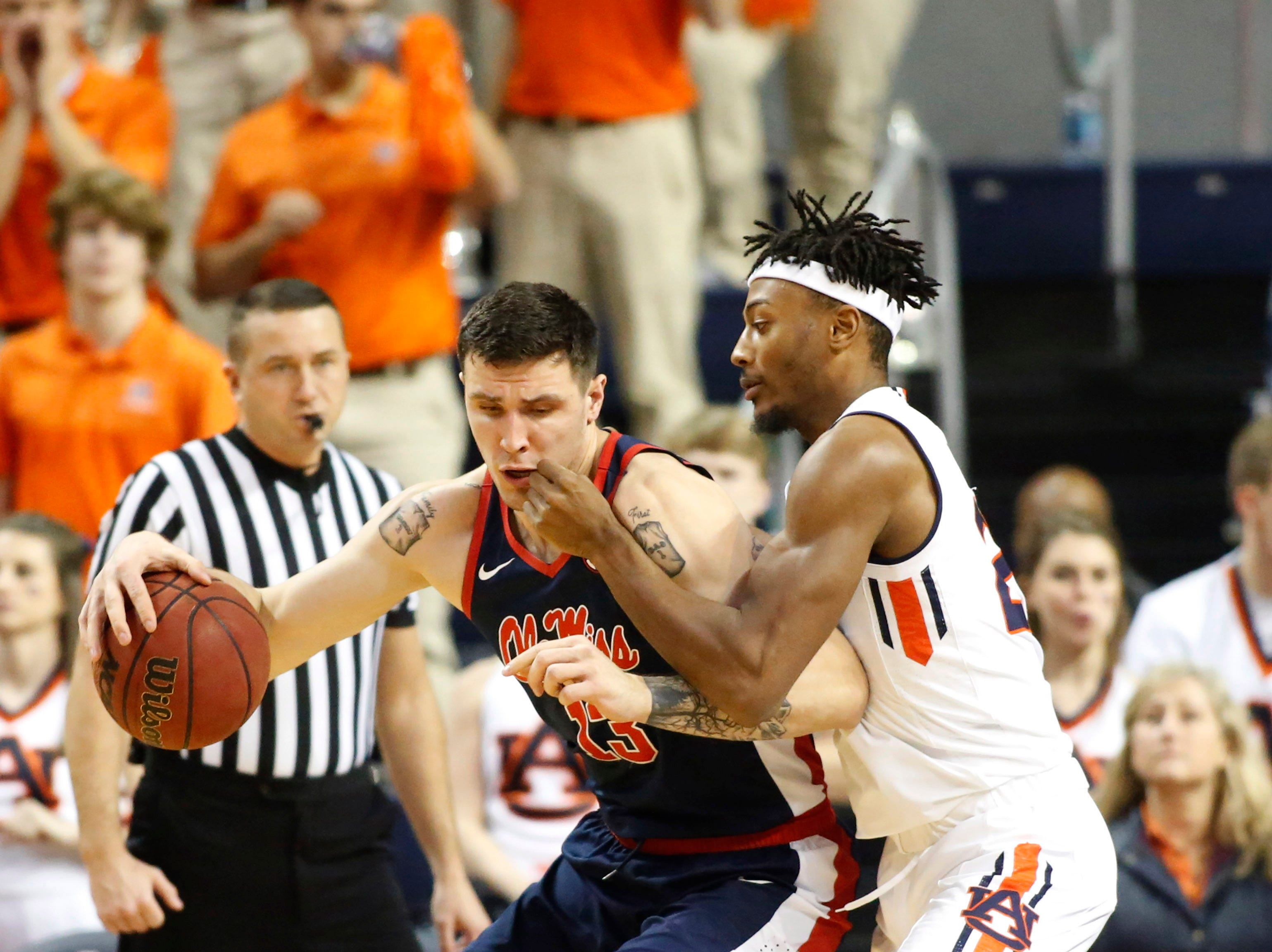 Feb 13, 2019; Auburn, AL, USA;  Ole Miss Rebels center Dominik Olejniczak (13) is pressured by Auburn Tigers forward Anfernee McLemore (24) during the second half at Auburn Arena. Mandatory Credit: John Reed-USA TODAY Sports