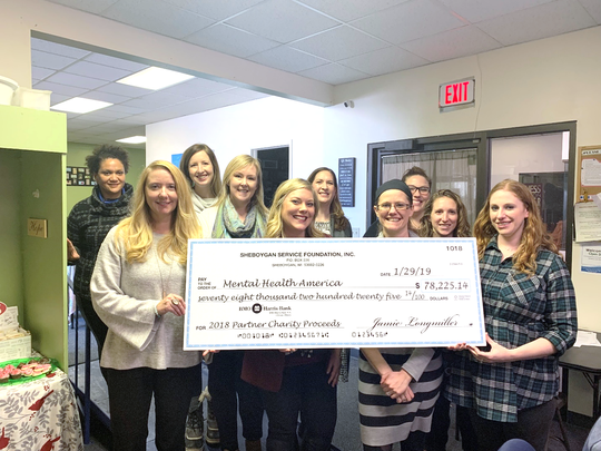 The Sheboygan Service Club (SSC) donated half of the money raised at its annual charity ball to Mental Health America of Sheboygan.