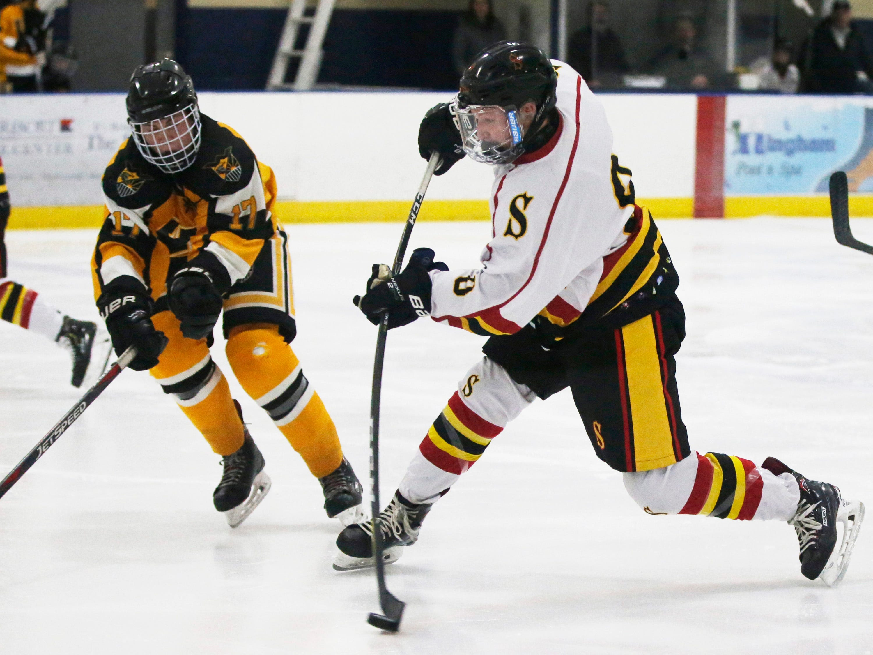 Sheboygan Red Raiders' Aaron Korpi (8, right) aims the puck against Waupun, Wednesday, February 13, 2019, in Sheboygan, Wis. The shot went into the goal.