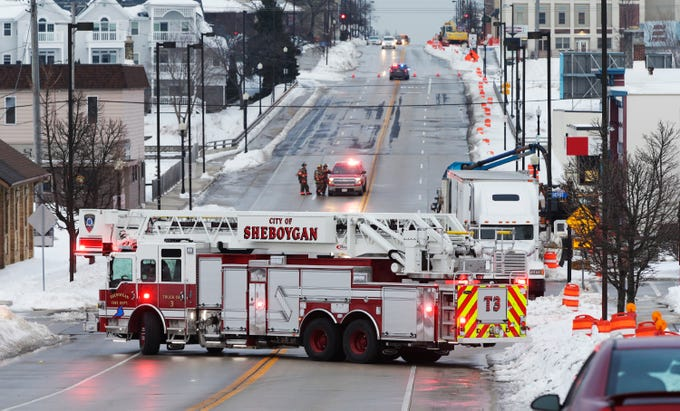 Pennsylvania Avenue is blocked off while Wisconsin Public Service workers fix a gas leak near Commerce Street, Thursday February 14, 2019, in Sheboygan, Wis. Sheboygan Police said that 300 homes lost gas service from the outage that is expected to last until 11 p.m.