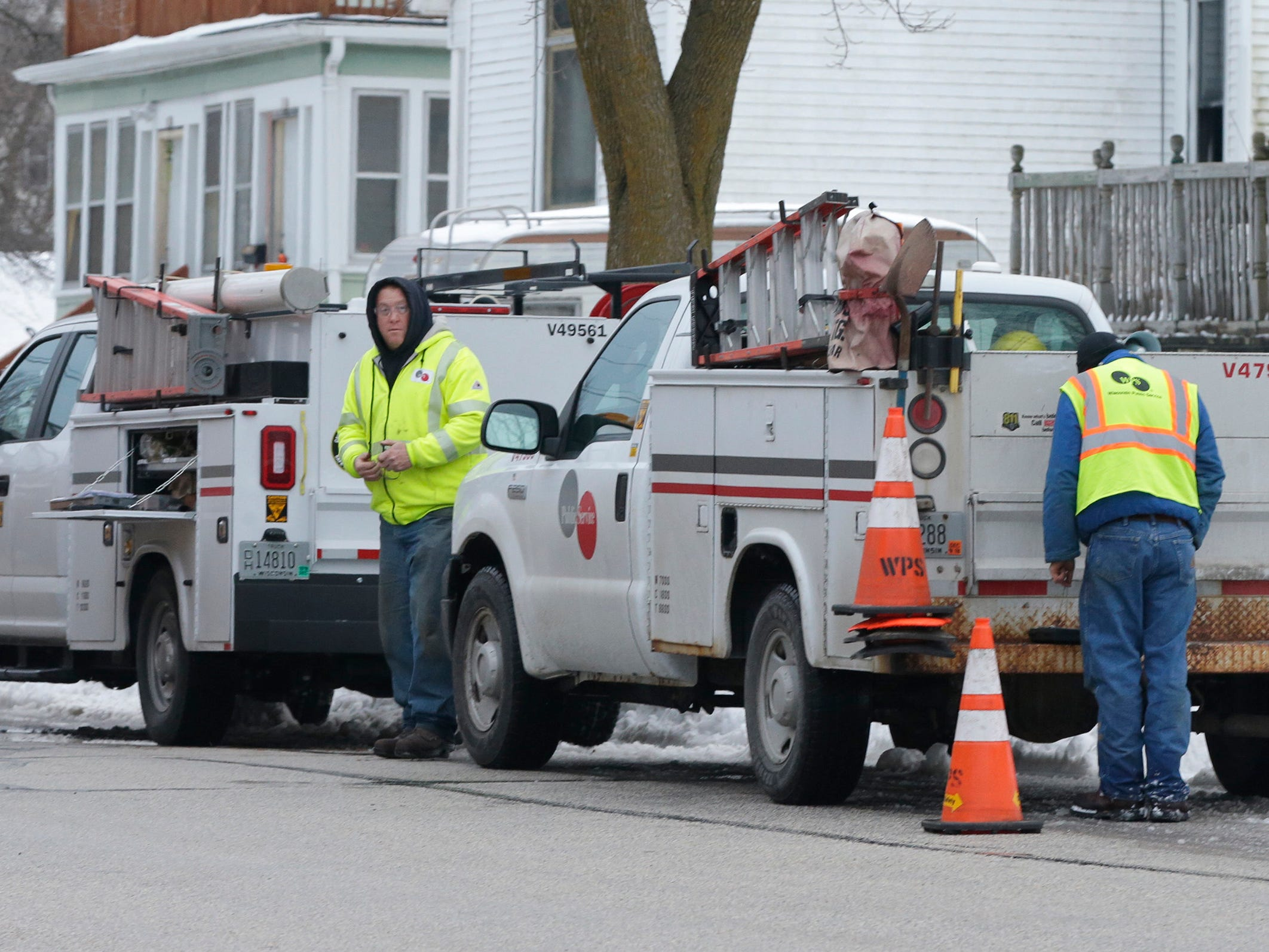 Wisconsin Public Service trucks park on North 13th Street near Pennsylvania Avenue and Commerce where crews were working on a gas leak, Thursday, February 14, 2019, in Sheboygan, Wis. Sheboygan Police said that 300 homes lost gas service from the outage that is expected to last until 11 p.m.