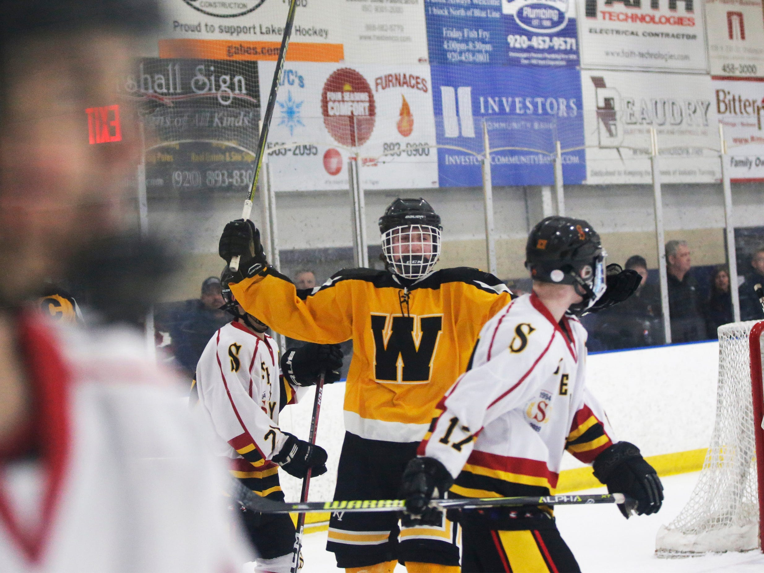 A Waupun player, center, celebrates his teams 2-1 victory over the Sheboygan Red Raiders, Wednesday, February 13, 2019, in Sheboygan, Wis.