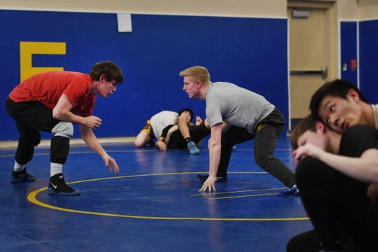 Canton's Jaden Dominisse, left, and Kellyn March, right, during wrestling practice Wednesday, Feb. 13, at Canton High School.