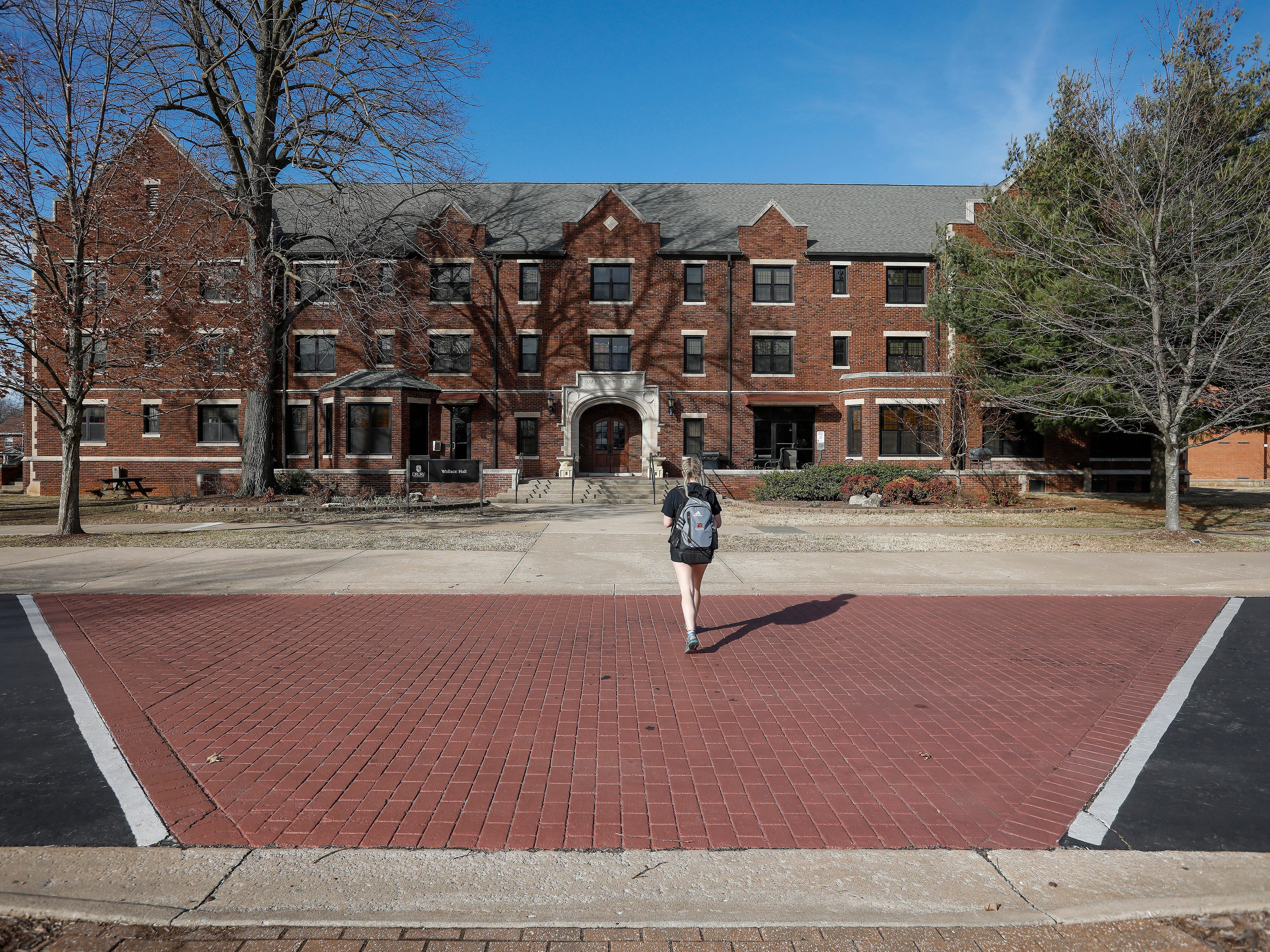 A student walks toward Wallace Hall on the campus of Drury University on Thursday, Feb. 14, 2019. Temperatures were in the low 60s on Thursday.