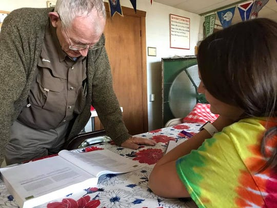 Pictured in this two-year-old photo, Kit Carson helps Sophie Scott with her physics homework.