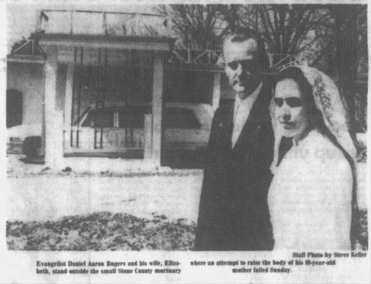 Evangelist Daniel Aaron Rogers and his wife, Elizabeth, stand outside the small Stone County mortuary where an attempt to raise the body of his 80-year-old mother failed on March 12, 1978.