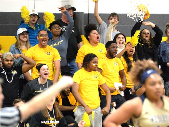 Mary Baldwin fans cheer their basketball team Wednesday in the opening round of the USA South Athletic Conference  tournament.