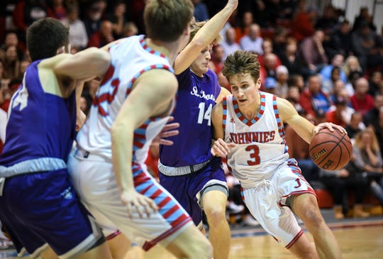 David Stokman of St. John's drives to the basket during the Wednesday, Feb. 13, game against St. Thomas in Collegeville.