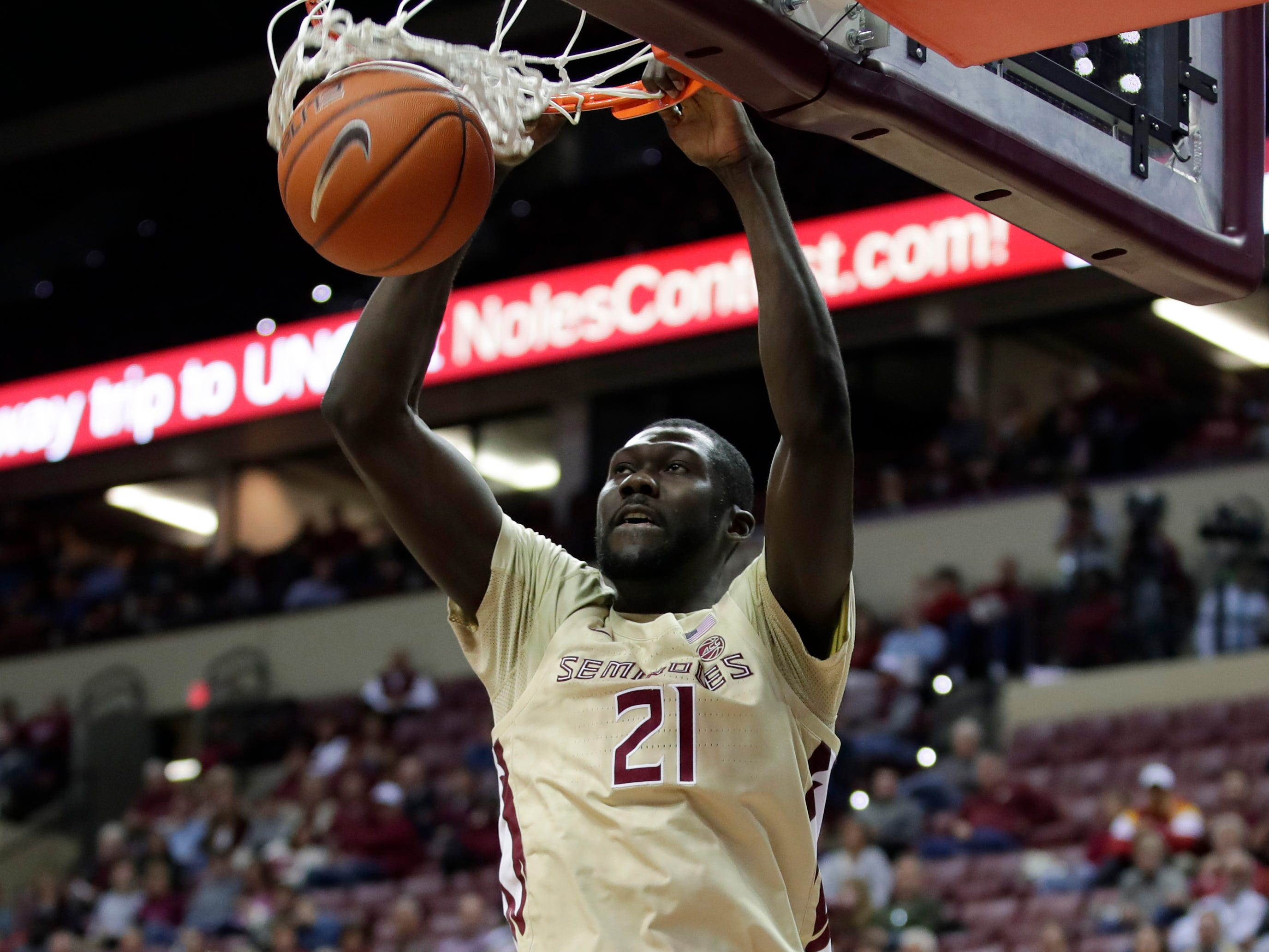 Florida State Seminoles center Christ Koumadje (21) dunks during a game between FSU and Wake Forest at the Donald L. Tucker Civic Center Wednesday, Feb. 13, 2019.