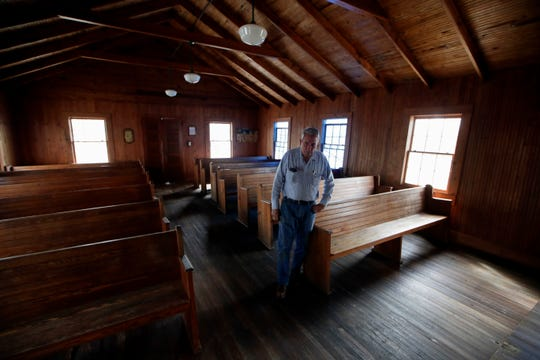 Panhandle Pioneer Settlement Found Willard Smith stands inside the Red Oak Methodist Church, which was heavily damaged during Hurricane Michael.