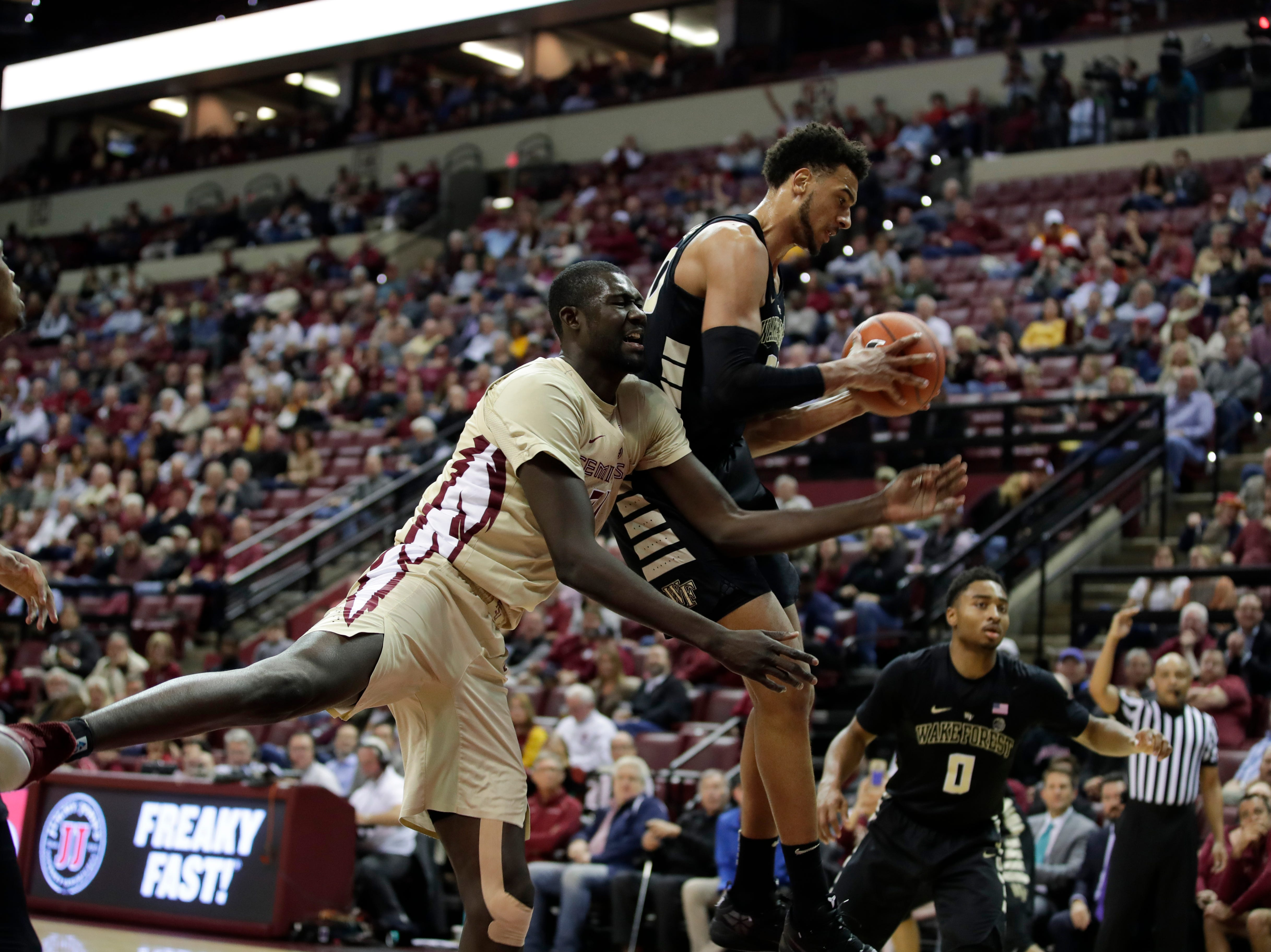 Florida State Seminoles center Christ Koumadje (21) misses a rebound during a game between FSU and Wake Forest at the Donald L. Tucker Civic Center Wednesday, Feb. 13, 2019.