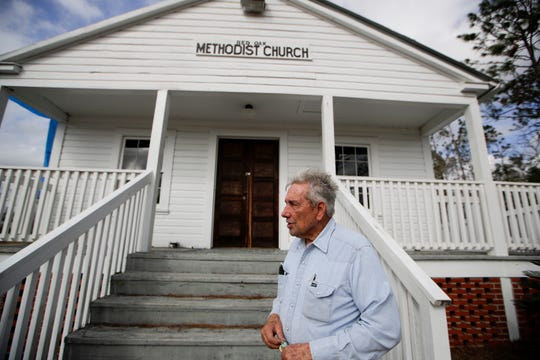 Panhandle Pioneer Settlement Found Willard Smith stands outside the Red Oak Methodist Church, which was heavily damaged during Hurricane Michael.