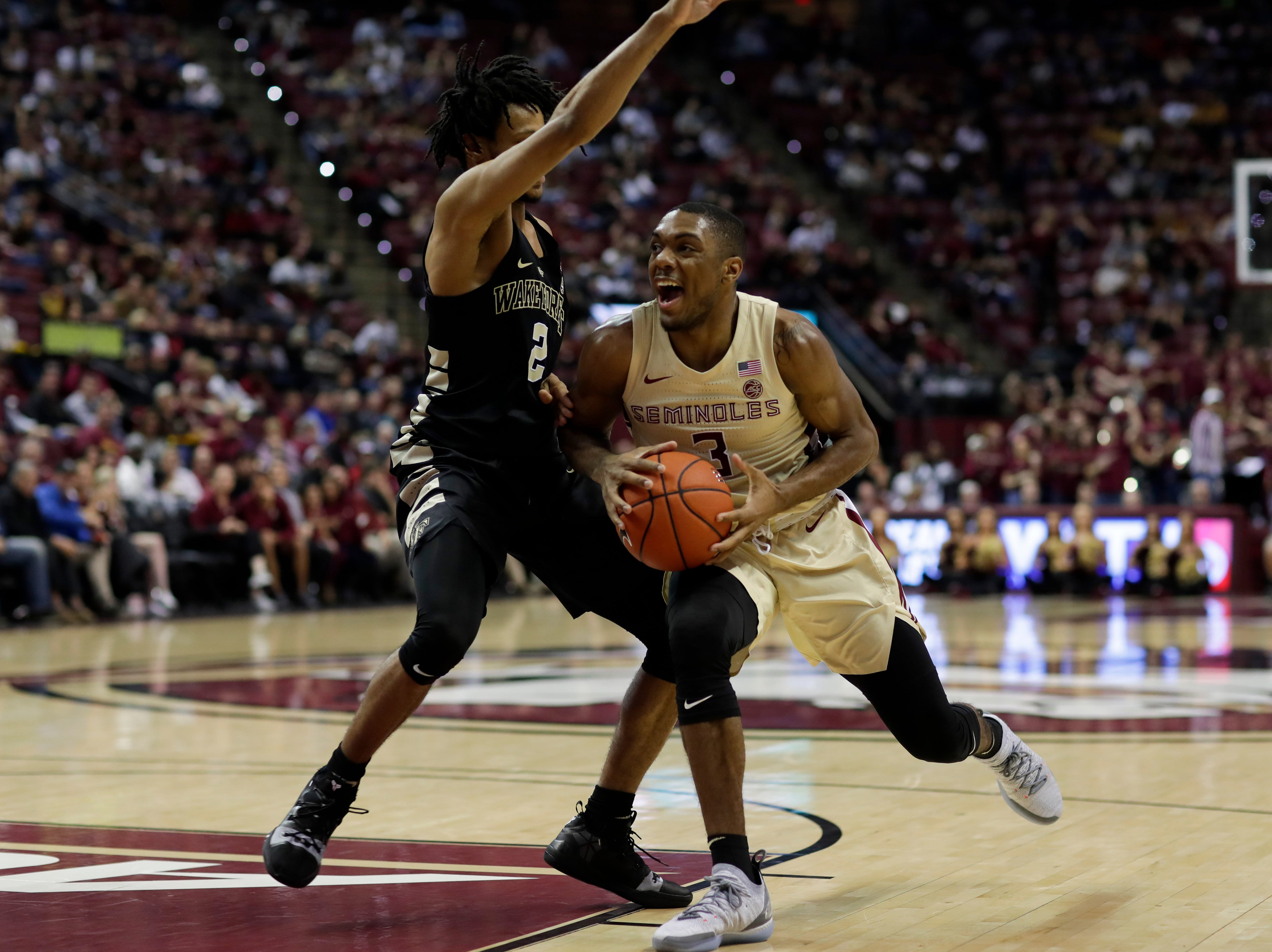 Florida State Seminoles guard Trent Forrest (3) meets a defender at the lane during a game between FSU and Wake Forest at the Donald L. Tucker Civic Center Wednesday, Feb. 13, 2019.