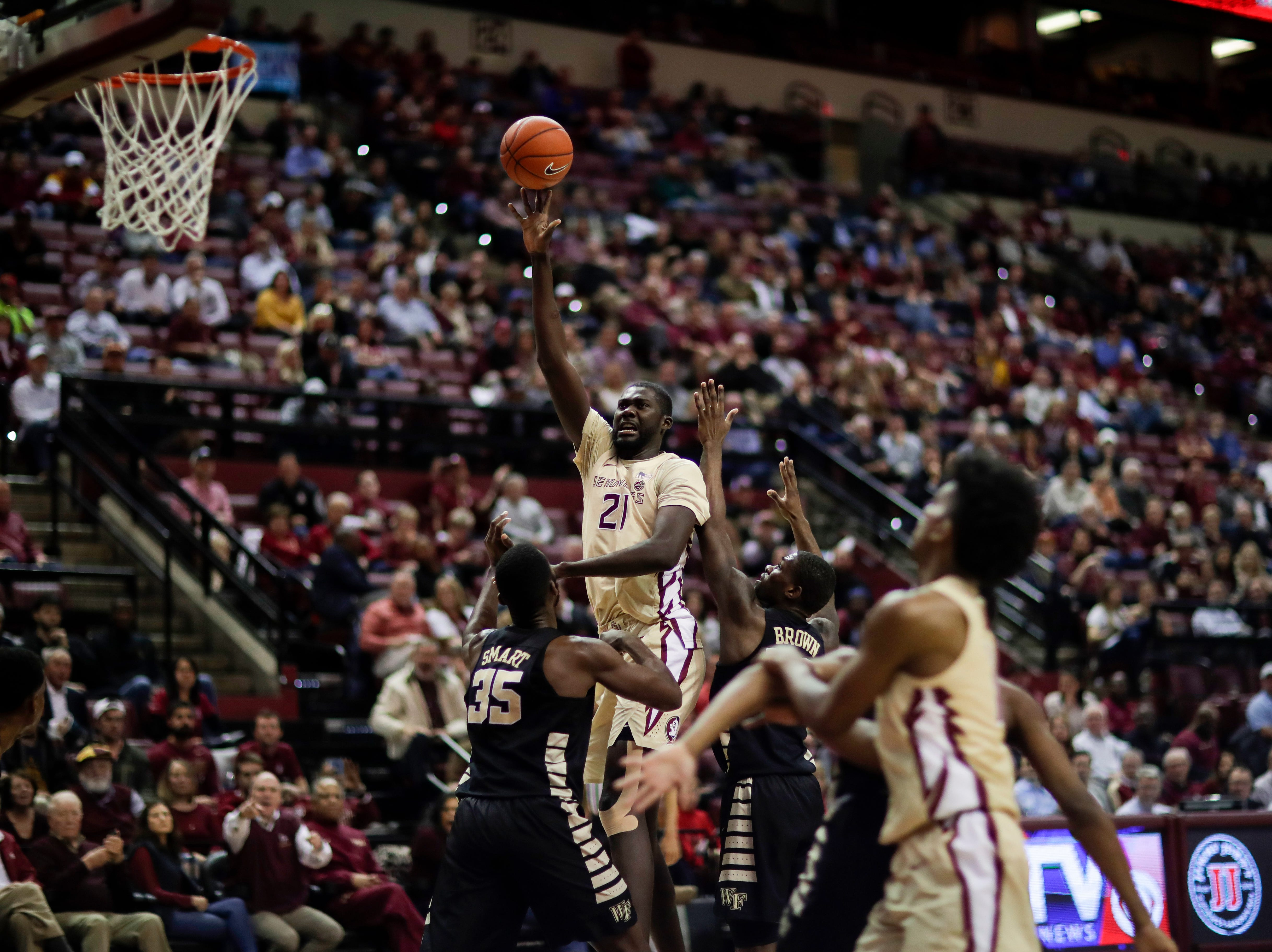 Florida State Seminoles center Christ Koumadje (21) tips up a shot during a game between FSU and Wake Forest at the Donald L. Tucker Civic Center Wednesday, Feb. 13, 2019.
