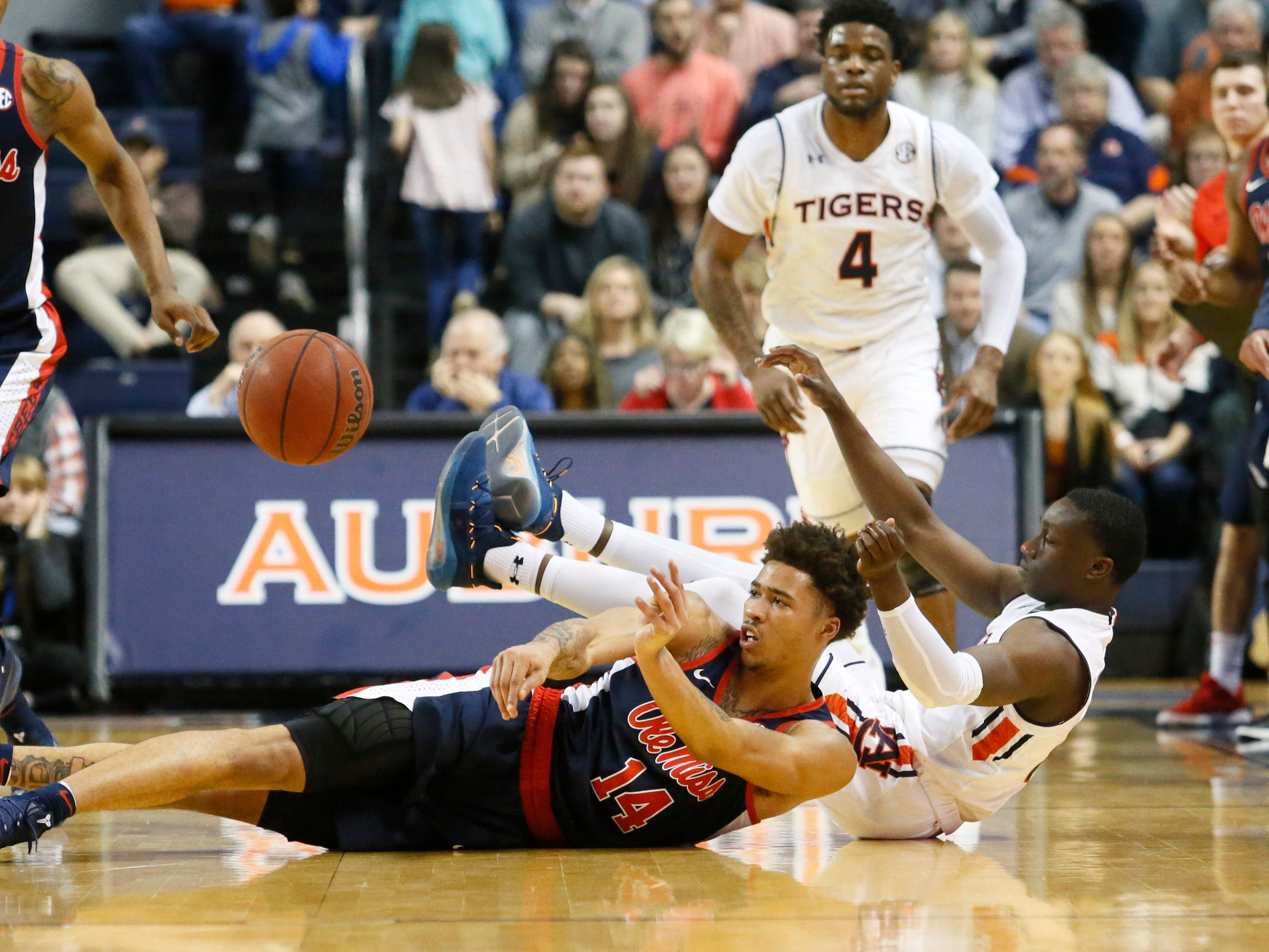 Feb 13, 2019; Auburn, AL, USA; Ole Miss Rebels forward KJ Buffen (14) makes a pass after taking the ball from Auburn Tigers guard Jared Harper (1) during the first half at Auburn Arena. Mandatory Credit: John Reed-USA TODAY Sports