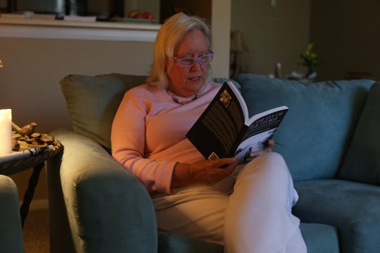 """Former Panama City resident Johanna Rucker, whose apartment was destroyed in Hurricane Michael, reads her poem included in the post-storm anthology, """"In the Eye of the Storm: Stories of Survival and Hope from the Florida Panhandle."""""""