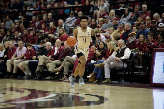 Florida State Seminoles guard David Nichols (11) dribbles up the court during a game between FSU and Wake Forest at the Donald L. Tucker Civic Center Wednesday, Feb. 13, 2019.
