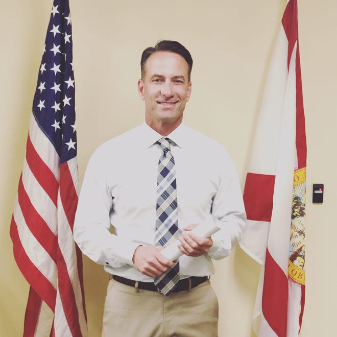 HD 7 candidate Mike Watkins with qualifying papers in hand at the Florida Division of Elections office, Wednesday, Feb. 13