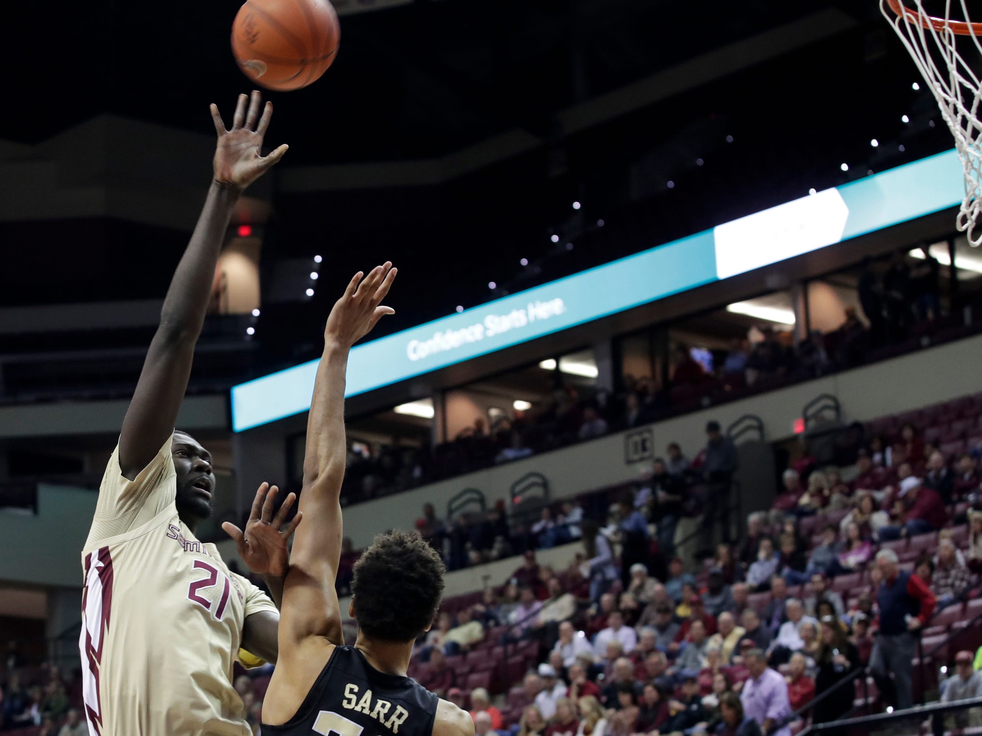Florida State Seminoles center Christ Koumadje (21) puts up a shot during a game between FSU and Wake Forest at the Donald L. Tucker Civic Center Wednesday, Feb. 13, 2019.