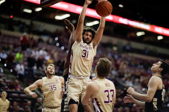 Florida State Seminoles guard Wyatt Wilkes (31) dunks during a game between FSU and Wake Forest at the Donald L. Tucker Civic Center Wednesday, Feb. 13, 2019.