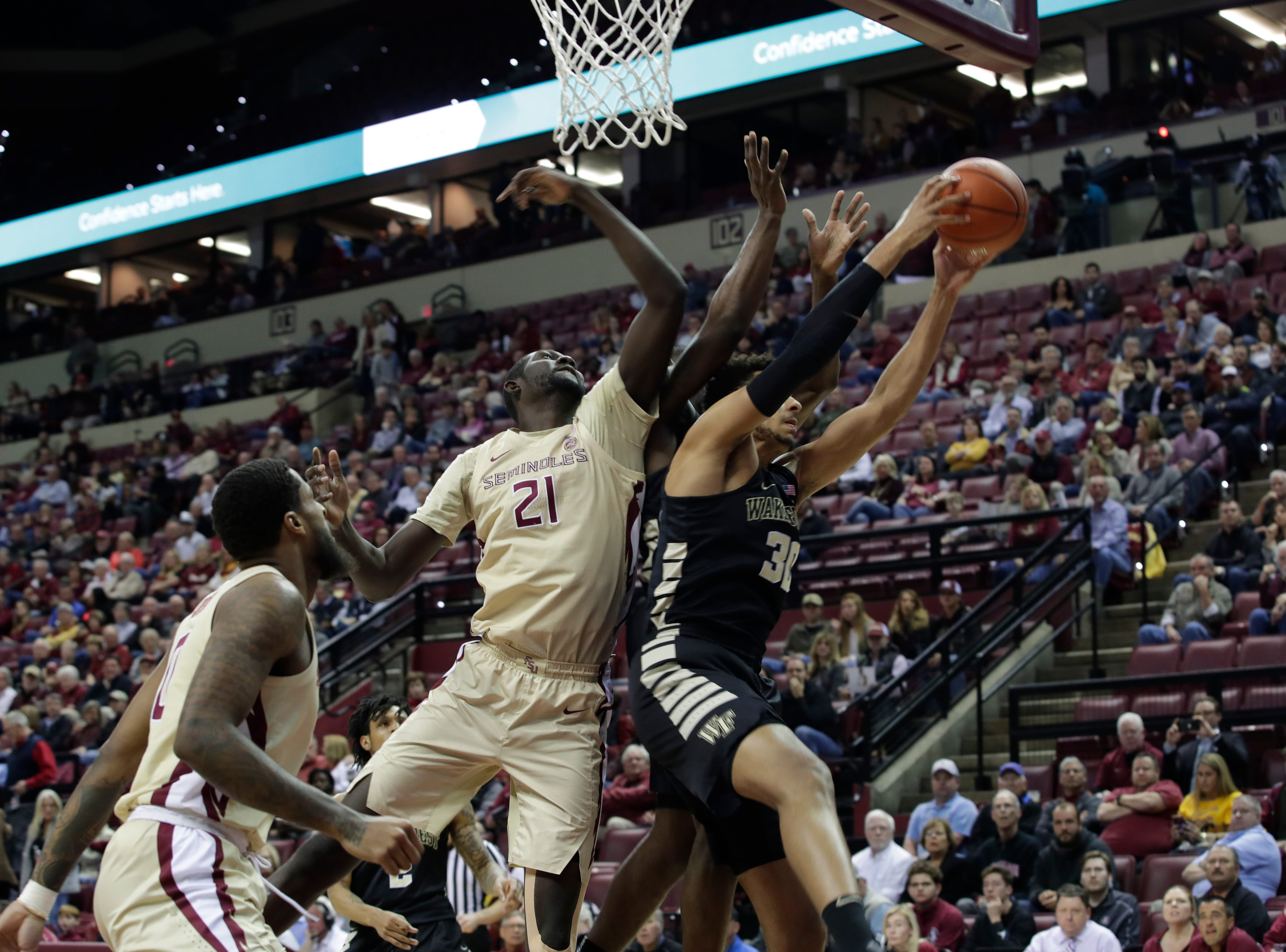 A rebound slips through the hands of Florida State Seminoles center Christ Koumadje (21) during a game between FSU and Wake Forest at the Donald L. Tucker Civic Center Wednesday, Feb. 13, 2019.