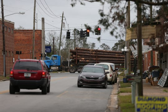 Logging trucks are a common sight on Highway 20 going through downtown Blountstown.
